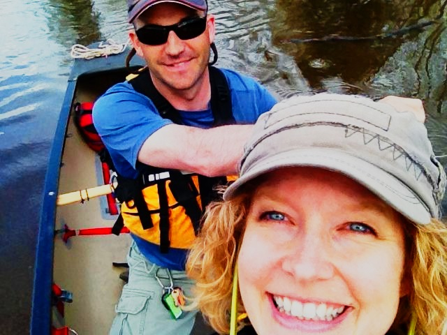 A little about my life... Chas Jones and his wife paddling their whitewater canoe